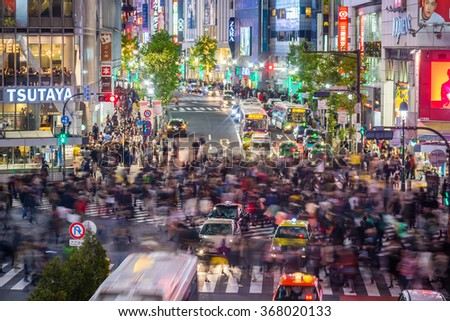 TOKYO, JAPAN - JANUARY 9: Top view view of Shibuya Crossing in Shibuya Tokyo on January 9, 2016, one of the busiest crosswalks in the world. - stock photo