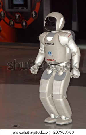 TOKYO, JAPAN - JULY 10: Ashimo in Odaiba on 10 July 2014. at Tokyo, Japan. Ashimo is a humaniod robot able to speak, run, sing and dance. She is very popular among the children. - stock photo
