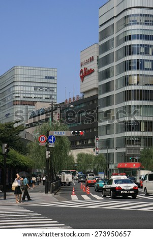 TOKYO,JAPAN-JULY 22:Busy traffic and stores at the GInza Shopping District. July 22,2008 in Tokyo,Japan. - stock photo