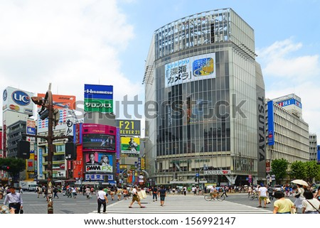 TOKYO, JAPAN - JULY 27: Crowds of people in the center of Shibuya in July 27 2013. It is the most popular commercial center in Tokyo, Japan. - stock photo