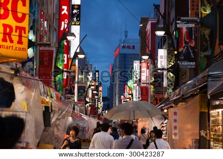 TOKYO,JAPAN - 3 Julyl 2015 :Ameyoko is a busy market street along the Yamanote near Ueno Stations.various products such as clothes, fresh fish, dried food and spices are sold along here - stock photo
