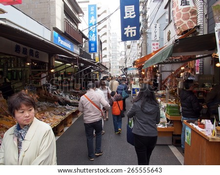TOKYO, JAPAN - MAR 28: Tsukiji Outer Market in Tokyo, Japan on March 28, 2015.  Tsukiji Outer Market is a part of Tsukiji Market which is the biggest wholesale fish market in the world. - stock photo