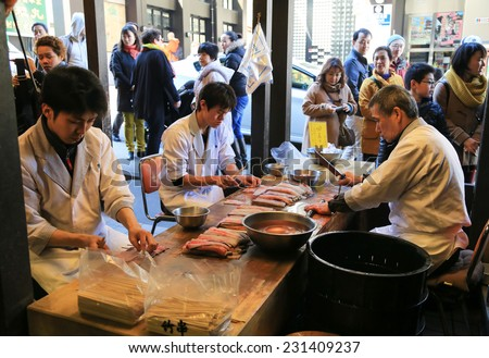 Tokyo, Japan - March, 21 2014 :  Japanese preparing fresh eel for cooking at the restaurant  in Tokyo - stock photo