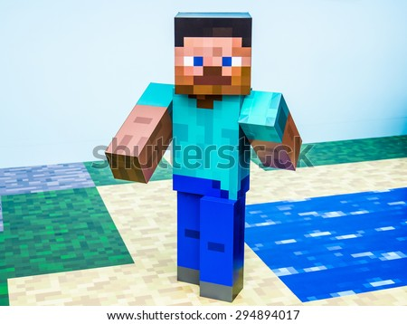 TOKYO, JAPAN - MARCH 20: Minecraft figure in Ginza district on March 20, 2015 in Tokyo, Japan. It is one of the world's best known shopping districts. - stock photo