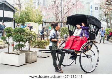 TOKYO, JAPAN - MARCH 19: Nakamise shopping street on March 19, 2015 in Tokyo, Japan.It connects Senso-ji Temple to Kaminarimon gate. - stock photo