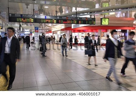 TOKYO, JAPAN - MAY 10, 2012: People hurry at Shinagawa Station in Tokyo. 477,000 daily passengers used the station in 2011. It is one of the busiest stations in Tokyo. - stock photo