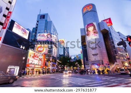 TOKYO,JAPAN -11 May 2015 :Shibuya is famous for its scramble crossing. It stops vehicles in all directions to allow pedestrians to inundate the entire intersection.  - stock photo