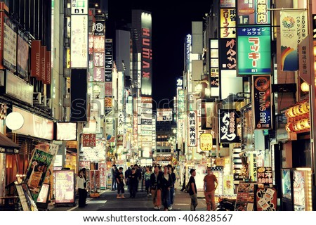 TOKYO, JAPAN - MAY 13: Shinjuku Street view at night on May 13, 2013 in Tokyo. Tokyo is the capital of Japan and the most populous metropolitan area in the world - stock photo