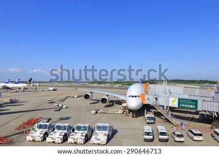 TOKYO, JAPAN - MAY 21: Thai Airways flight at the docking in Narita International Airport, Tokyo, Japan on May 21, 2015 - stock photo