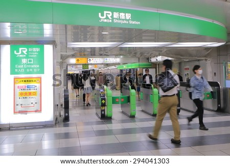 TOKYO JAPAN - MAY 8, 2015: Unidentified people commute at Shinjuku train station. Shinjuku train station is the busiest train station in the world used by more than 2 million people every day.  - stock photo