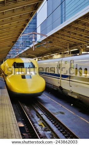 """TOKYO, JAPAN --1 NOVEMBER 2014-- A """"Doctor Yellow"""" nozomi Shinkansen high-speed bullet train enters the Tokyo station, which celebrated its 100th anniversary in December 2014.  - stock photo"""