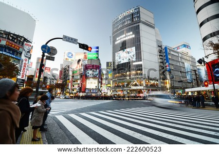 Tokyo, Japan - November 28, 2013: Crowds of people crossing the center of Shibuya district on November 28 2013, Shibuya is the most important commercial center in Tokyo, Japan  - stock photo