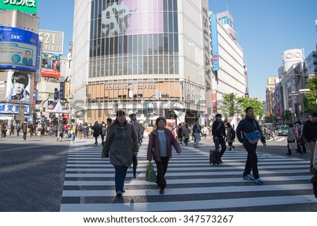 Tokyo, Japan - November 28, 2015: Q-Front building near Shibuya Crossing. It is a famous meeting point and landmark. Many people get there to look at a panoramic view of Shibuya station and crossing. - stock photo