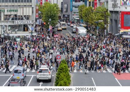 TOKYO, JAPAN - NOVEMBER 02, 2014: Unidentified pedestrians walk at Shibuya Crossing, one of the busiest crosswalks in the world. - stock photo