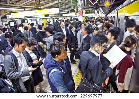 TOKYO, JAPAN - OCTOBER 28. 2014: Passengers hurry at Akihabara crowd station in Tokyo, Japan.   Akihabara is one of the world's few Electric Towns - stock photo