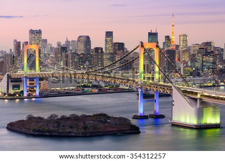 Tokyo, Japan skyline with Rainbow Bridge and Tokyo Tower. - stock photo