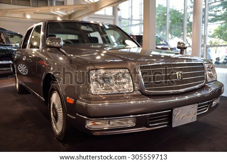 TOKYO - JULY 31, 2015: A Toyota Century in Toyota Mega Web showroom on Odaiba island. This limousine is produced mainly for the Japanese market and is Toyota's flagship car.  - stock photo