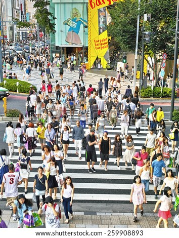 TOKYO - JULY 26, 2014: Pedestrian crossing in the corner of La Foret Harajuku fashion building and Tokyu Plaza shopping complex in Omotesando and Harajuku area, downtown Tokyo. - stock photo