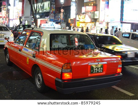 TOKYO - JULY 5: Taxi stuck in traffic July 5, 2011 in Tokyo, Japan. Taxi fares go up considerably at late hours in Japan. - stock photo