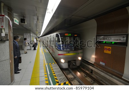 TOKYO - JULY 5: Train arrives on the Oedo Line at Tochomae Station July 5, 2011 in Tokyo, Japan. The line is Tokyo's first linear motor metro line. - stock photo