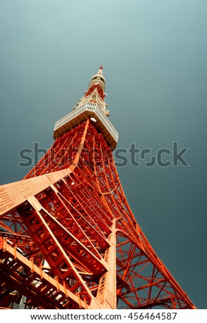 Tokyo - May 2016: Tokyo tower bottom view against blue sky. Retro look. - stock photo