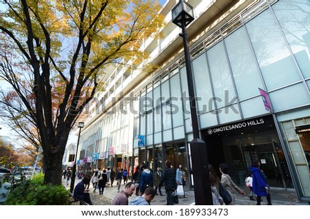 TOKYO - NOV 24: People shopping in Omotesando Hills on november 2013,24  Omotesando Hills consists of six floors of about 100 upmarket shops, cafes, restaurants and beauty salons. - stock photo