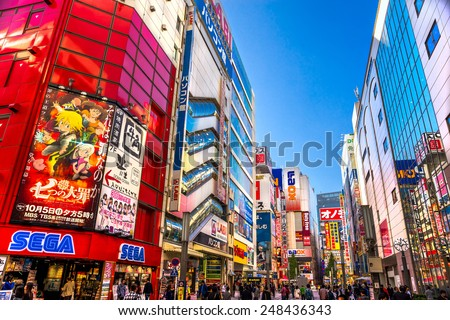 TOKYO - NOVEMBER 13: Akihabara district November13, 2014 in Tokyo, JP. The district is a major shopping area for electronic, computer, anime, games and otaku goods. - stock photo