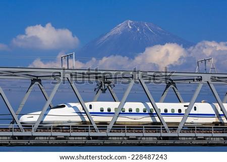 TOKYO - October 19: Shinkansen bullet train at Tokyo railway station in October 19, 2014 Tokyo, Japan. The Tokaido Shinkansen operate between Tokyo and Osaka and stop at Yokohama, Nagoya, Kyoto. - stock photo