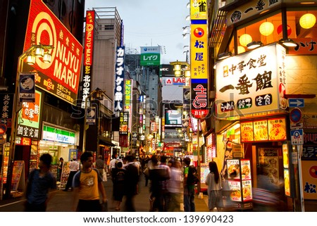 TOKYO - SEP 8: Kabuki-cho in Shinjuku is a night entertainment area of Tokyo September 8, 2012 in Tokyo, Japan. It hosts many hotels, stores, electronic and camera shops, restaurants,pub for visitors - stock photo