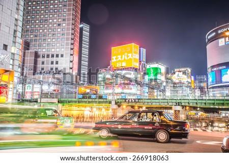"""Tokyo, Shinjuku. February 9, 2015. Shinjuku cross. Shinjuku (??? Shinjuku-ku """"New Lodge"""") is a special ward located in Tokyo Metropolis, Japan. It is a major commercial and administrative centre  - stock photo"""