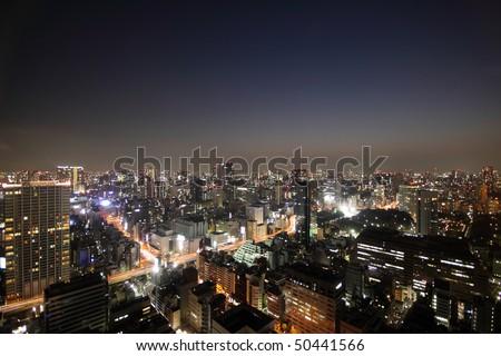 Tokyo skyline light up during sunset - stock photo
