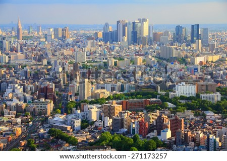 Tokyo skyline - urban sprawl cityscape with Toshima and Shinjuku wards. Warm sunset light. - stock photo