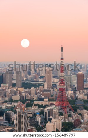 Tokyo Tower at dusk with the moon rising. - stock photo