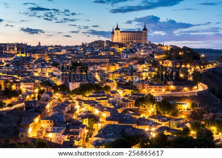 Toledo Cityscape with Alcazar at dusk in Madrid Spain - stock photo