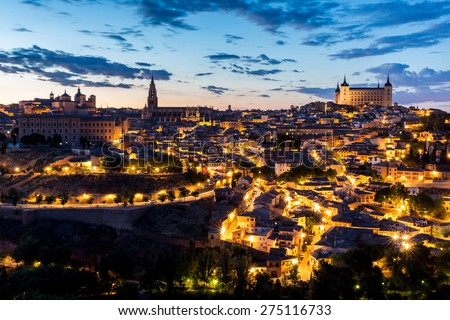 Toledo Cityscape with Alcazar at dusk in Madrid Spain - stock photo