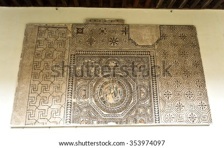 TOLEDO, SPAIN - SEPTEMBER 6 2015: Mosaic dating from the 3rd century AD in the Museum of Santa Cruz, on September 6, 2015, in Toledo, Spain - stock photo
