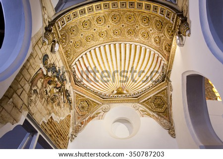 TOLEDO, SPAIN - SEPTEMBER 5 2015: View of the clam-shell topped arch at the center of the Synagogue Santa Maria la Blanca, on September 5, 2015, in Toledo, Spain - stock photo