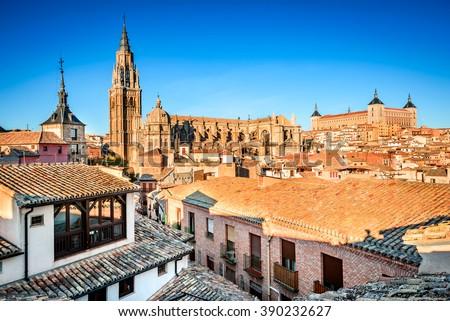 Toledo, Spain. Sunset HDR view of ancient city Toledo in Castilla la Mancha with Santa Iglesia Catedral and Alcazar. - stock photo