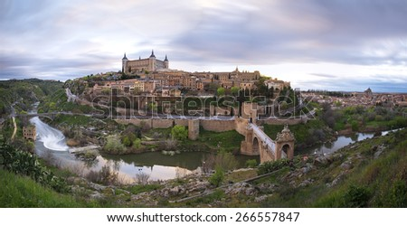 Toledo, Spain town skyline on the Tagus River at sunset - stock photo
