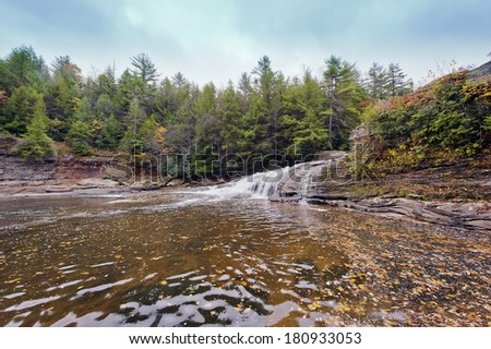 Tolliver waterfall during Autumn in the Appalachian mountains of Maryland - stock photo