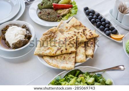 Tolma, Pkhali, khachapuri bread and black olives - traditional food in Georgia - stock photo