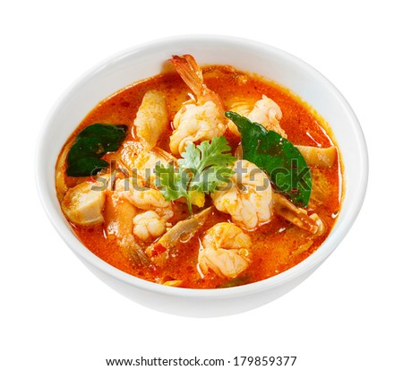 Tom yam koong - Thai spicy prawn or shrimp and lemon grass soup with mushrooms - deep focus image with path - stock photo