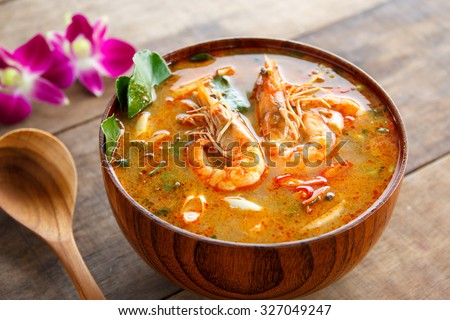 Tom Yam Kung ,thai food in wooden bowl  - stock photo