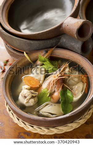 Tom Yam Ruam Pak or Clear Tom Yam Soup with Chicken and Prawns. Non sharpen - stock photo