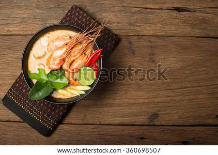 Tom Yum Goong traditional thai food cuisine in Thailand on wooden background - stock photo