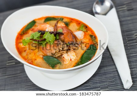 Tom Yum Kung-Thai spicy and sour soup.It has been popularised around the world. - stock photo