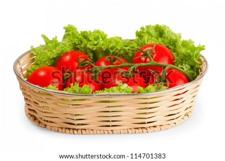 Tomate with salad in basket on white background - stock photo