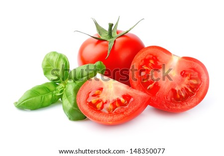 Tomato and basil leaves isolated  - stock photo