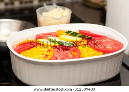 tomato bake casserole with zucchini and potato and sweet onion, delicious vegetarian paleo diet - stock photo
