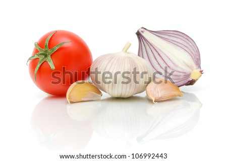 tomato, garlic and onion on a white background close-up of the reflection - stock photo